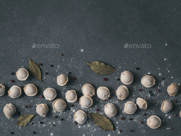 Beautiful scattered raw pelmeni on marble background - Stock Photo - Images