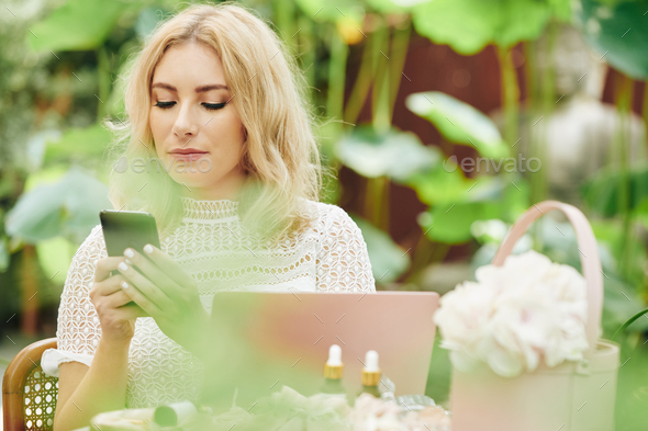 Business lady reading text messages - Stock Photo - Images
