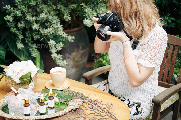 Woman photographing organic cosmetics - Stock Photo - Images