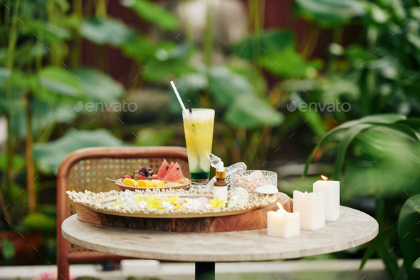 Cocktail and fruits on small table - Stock Photo - Images
