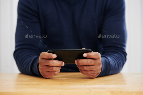 Man using mobile phone - Stock Photo - Images