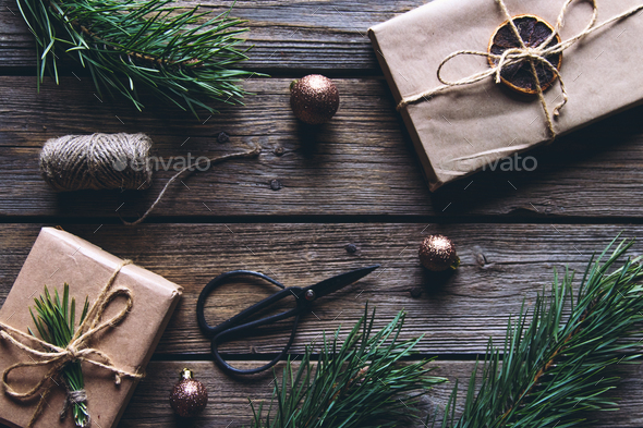 Handmade craft Christmas box for gifts and decor elements in the form of fir cones, pine branches - Stock Photo - Images