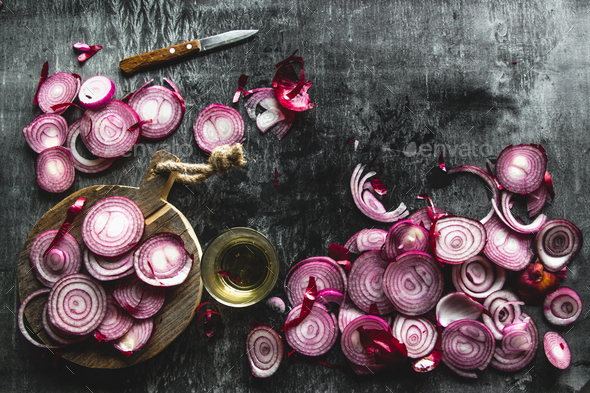 red onions cut into slices on a black background in rustic style. the view from the top. copyspace - Stock Photo - Images