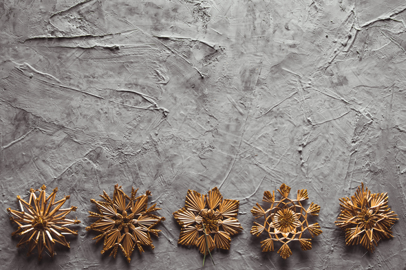New Year's straw toys, on a gray concrete background. Christmas card - Stock Photo - Images