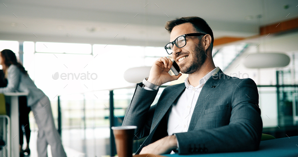 Inspired businesman sitting at coffee-break - Stock Photo - Images