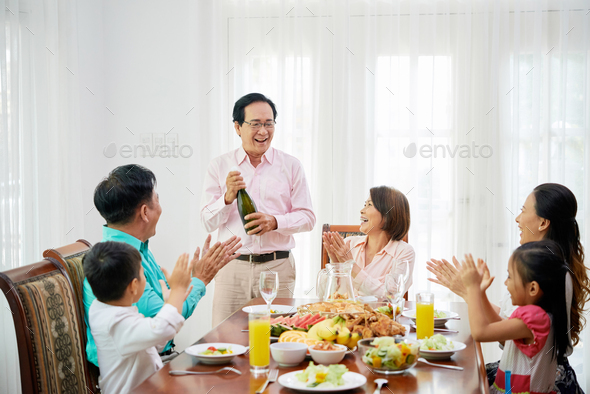 Opening champagne bottle - Stock Photo - Images