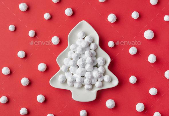 cranberries covered with powdered sugar on fir shape plate - Stock Photo - Images