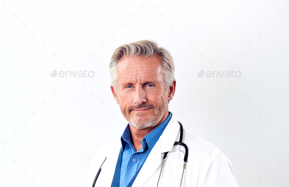 Studio Shot Of Mature Male Doctor Wearing White Coat And Stethoscope Against White Background - Stock Photo - Images