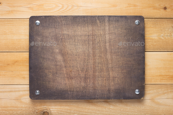 wooden sign board at wall - Stock Photo - Images