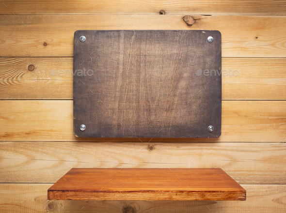 wooden sign board and shelf at wall - Stock Photo - Images