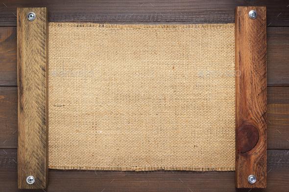 burlap hessian sacking texture on wood - Stock Photo - Images