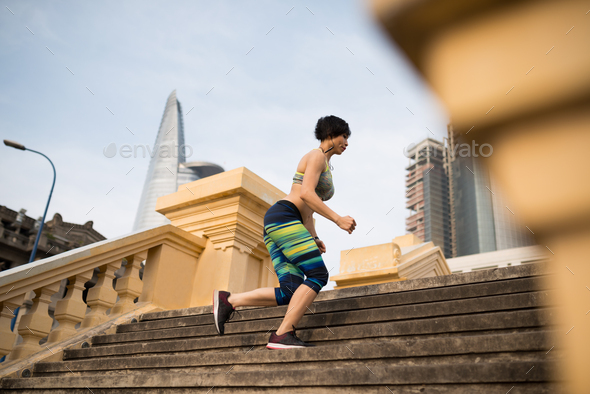 Jogging young woman - Stock Photo - Images