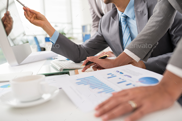 Business executives discussing work - Stock Photo - Images