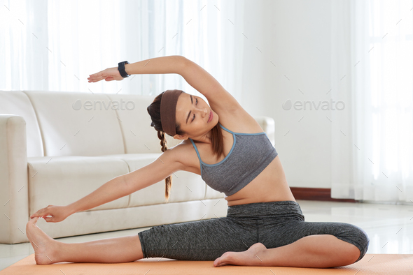 Woman Stretching At Home - Stock Photo - Images