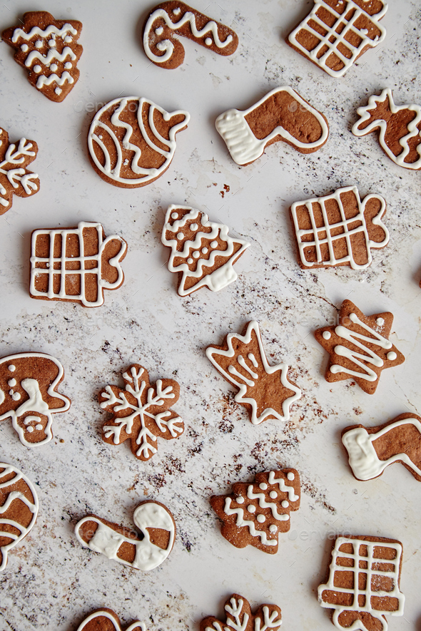 Composition of delicious gingerbread cookies shaped in various Christmas symbols - Stock Photo - Images