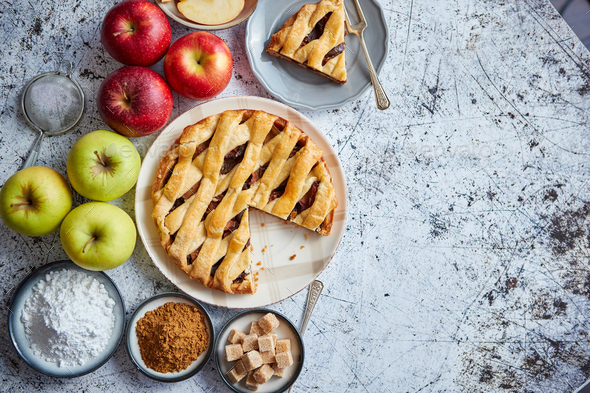 Delicious apple pie cake with a fresh fruits, brown and powder sugar - Stock Photo - Images