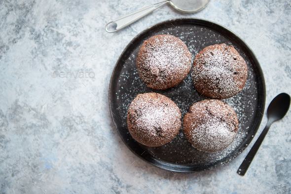 Fresh and tasty chocolate muffins served on plate - Stock Photo - Images