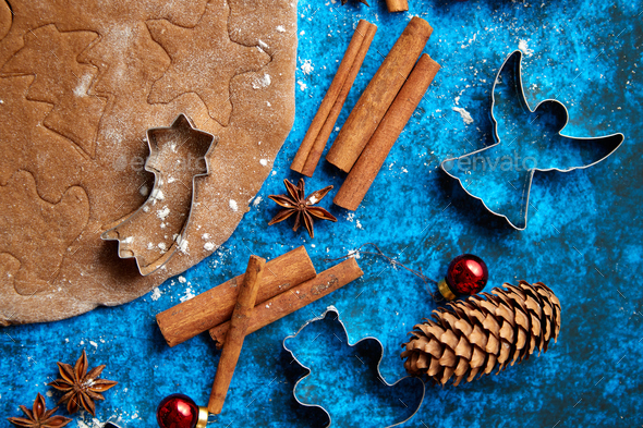 Christmas baking concept. Gingerbread dough with different cutter shapes - Stock Photo - Images