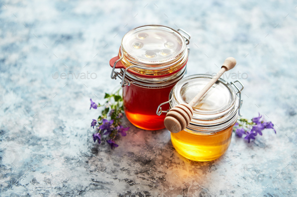 Jars with different kinds of fresh organic honey - Stock Photo - Images