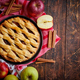 Homemade pastry apple pie with bakery products on dark wooden kitchen table - PhotoDune Item for Sale