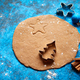 Christmas baking concept. Gingerbread dough with different cutter shapes - PhotoDune Item for Sale