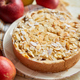 Freshly baked homemade apple pie with almond flakes cake on yellow - PhotoDune Item for Sale