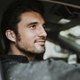 Handsome male driver sitting in a car - PhotoDune Item for Sale