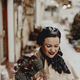 Happy woman holding a bouquet of flowers in the wintertime - PhotoDune Item for Sale