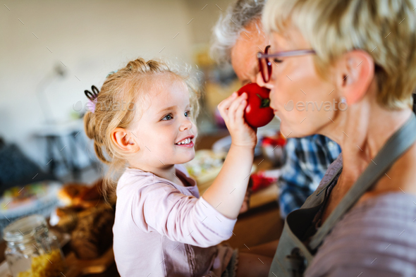 Grandparents playing and having fun with their granddaughter - Stock Photo - Images