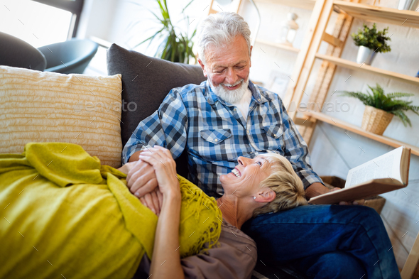 Happy senior couple relaxing at home together - Stock Photo - Images