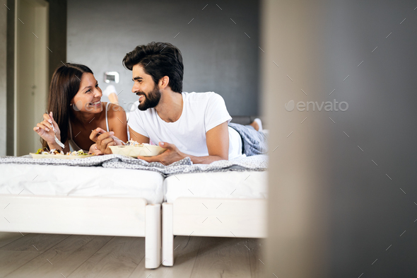 Loving couple having breakfast in bed. Loving couple. Family relationships - Stock Photo - Images