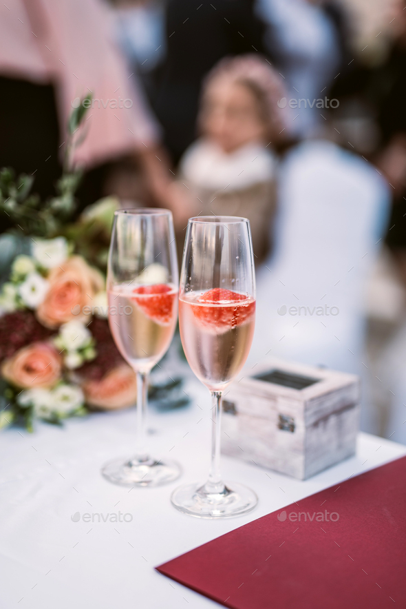 Strawberry in champagne in glasses - Stock Photo - Images