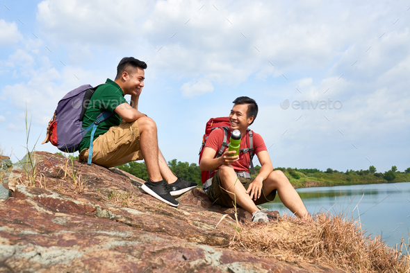 Hikers resting on mountain top - Stock Photo - Images