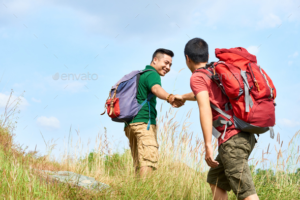 Climbing hikers - Stock Photo - Images
