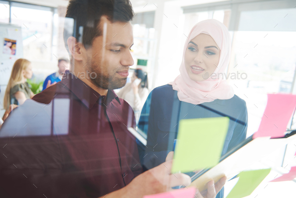 BUsiness couple exchaning new ideas - Stock Photo - Images
