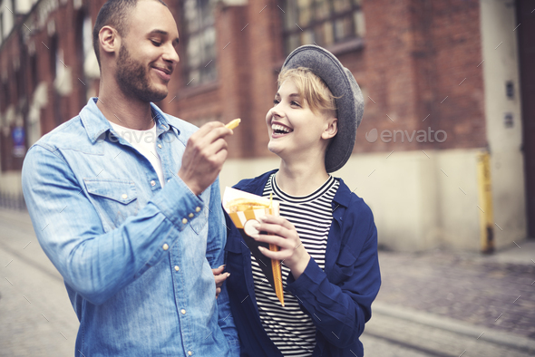 Top view of couple eating fast food - Stock Photo - Images