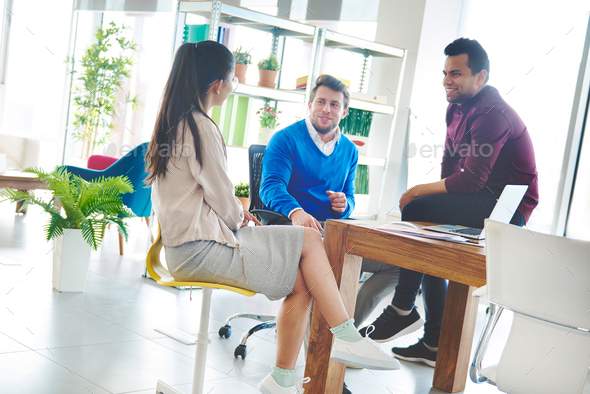 Multi ethinc group having relaxing time at work. - Stock Photo - Images