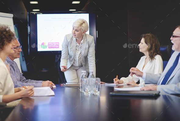 Senior adult woman leading in conference - Stock Photo - Images