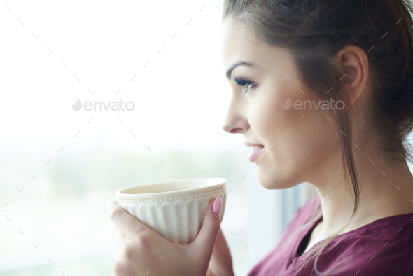 Headshot of attractive woman having morning coffee - Stock Photo - Images