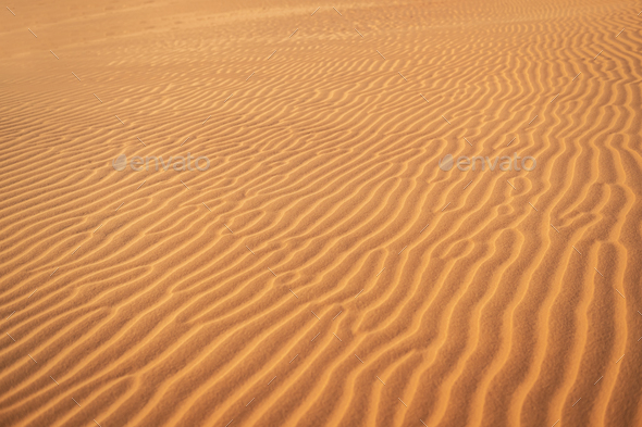 Abstract background and texture of sand waves in desert - Stock Photo - Images