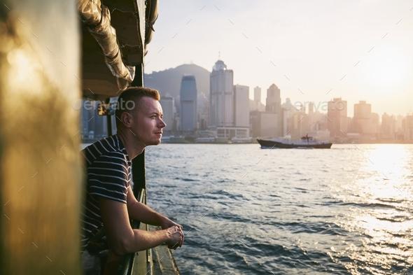 Travele on boat at sunset - Stock Photo - Images