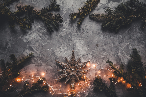 Holiday frame of Christmas decorations on blue dark stucco concrete background with fir branch - Stock Photo - Images