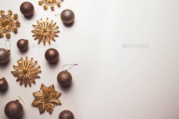 Creative arrangement of bright straw christmas toys on white background. flat lay, top view - Stock Photo - Images