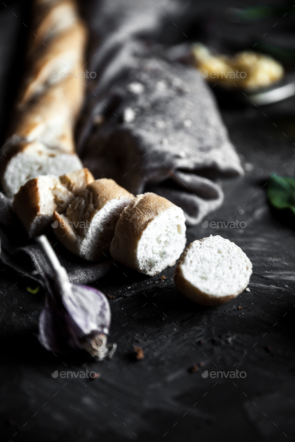 French pastry, baguette on a black background with details for cooking - Stock Photo - Images