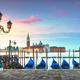 Venice lagoon, San Giorgio church, gondolas and poles. Italy - PhotoDune Item for Sale