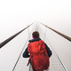 Female tourist walking across a suspension bridge in heavy fog - PhotoDune Item for Sale