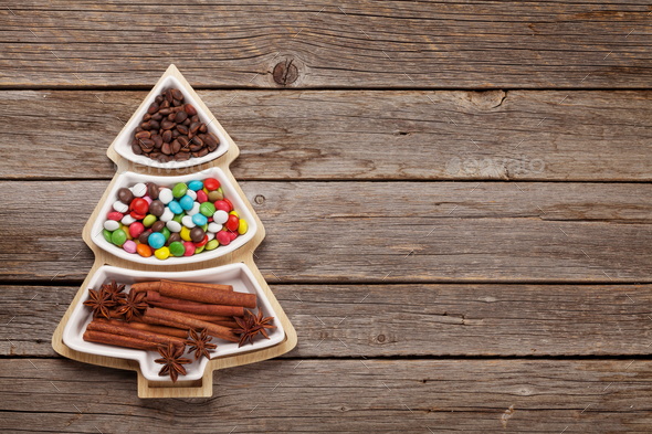 Christmas card with spices, sweets and nuts - Stock Photo - Images