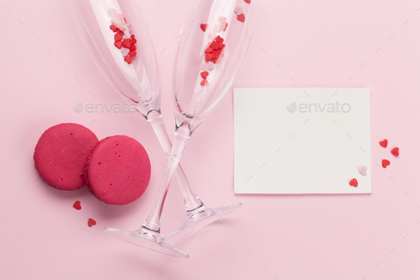 Champagne glasses and heart shaped sweets holiday - Stock Photo - Images