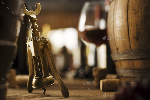 Wine tasting in the cellar and vintage corkscrew - Stock Photo - Images