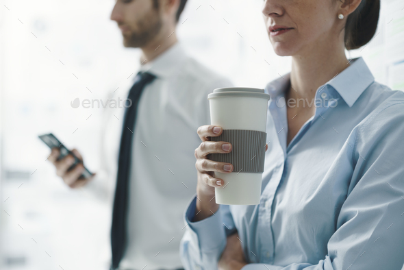 Business people having a meeting - Stock Photo - Images